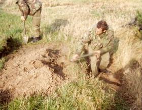 Sgt Keddie leading the way digging in, 10 PARA Annual Camp Denmark, 1981.