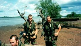 Pte Duddridge, Pte Ingram standing with Pte Fryer in front, Sierra Leone, May 2000.