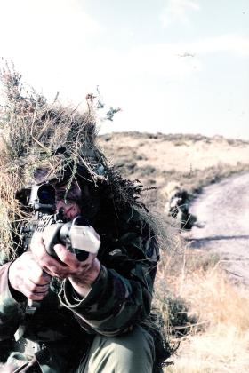 Taking aim with a SA80 rifle, c1985.