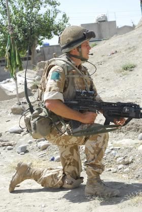 3 PARA soldier patrolling with SA80A2 Under slung Grenade Launcher, Kandahar, Afghanistan, June 2008