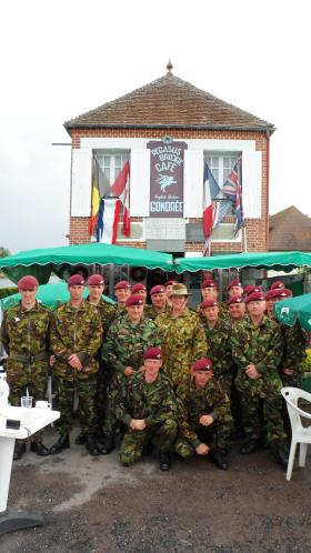 Members of 4 PARA outside Café Gondrée at Pegasus Bridge, Normandy, June 2012.