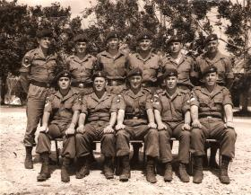 Group photograph of QM Staff Jungle Warfare School, Ulu Tiram, Borneo, Feb 1965.