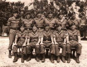 Group photograph of QM Staff Jungle Warfare School, Ulu Tiram, Borneo, Feb 1965.