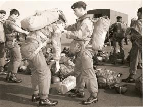 Soldiers from Para Sqn RAC in preparation for parachute drop, Boscombe Down, 1970