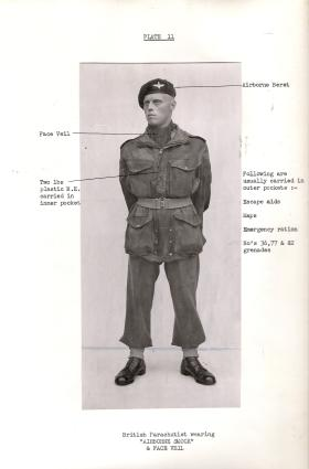"British Parachutist wearing ""Airborne smock"" and face veil, c1944."