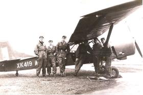 Group photograph in front of an Auster