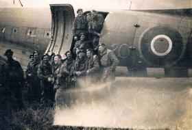 Members of 7th (LI) Para Bn pose for a group shot in front of an RAF Dakota c 1945/6