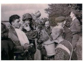 Sgt A V Tennuci (with helmet) at DZ-X Arnhem 17 September 1944