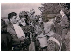 Sgt A V Tennuci (with helmet) at DZ-X Arnhem 17 September 1944