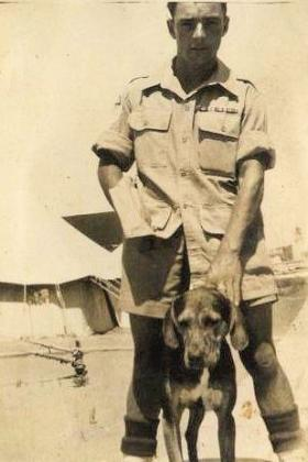 Sgt Roy Burns with 'mascot' Palestine c1946
