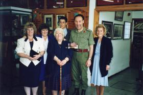 The family of George Hurry present his medals to the Regimental Colonel for the Airborne Museum, Aldershot, 1991.