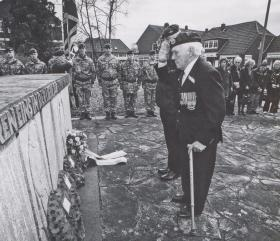 Des Page salutes his fallen comrades in Hamminkeln, March 2015.