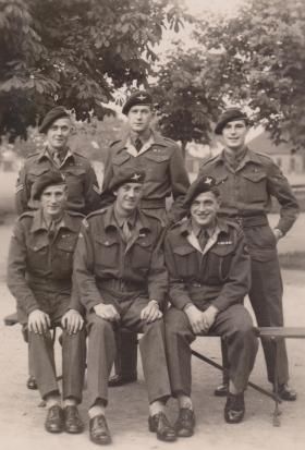 Cpl 'Daniel' Jones, standing on left, after he had returned to the UK, c1945.