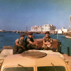 Dvr John Silcock, Cpl Brian Jones and Dvr Tom Cassidy on a Bedford Water Carrier, Bahrain, c1964.