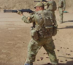 Sgt Blakey shooting the Combat Shotgun on Bastion range, Herrick XIII, Afghanistan, 2010.
