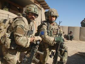 The soldier on the left has a painted Mk 7 helmet in lieu of a cover, 2 PARA, Afghanistan, 2010.