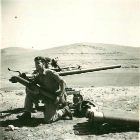 Soldiers of 2 PARA prepare to load a 106mm Anti-Tank Gun, Jordan, 1958