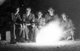 Group of men around a fire, Palestine, c1946.