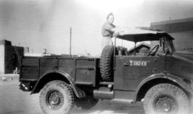 L/Cpl Bixby with Morris Truck, Palestine.