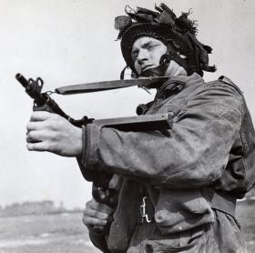 An airborne soldier with a STEN sub machine gun, c1944.