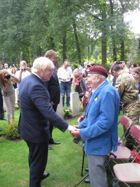Stephen Morgan at Oosterbeek War Cemetery talking to foreign secretary Boris Johnson, 16 September 2016.