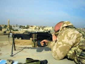 Pte Steve Lewis with a Light Machine Gun, Iraq, 2005.