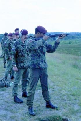 Steve Lewis with M1 carbine, with 'Skiddy' and Andy Mason in the background, 1 PARA, date unknown.