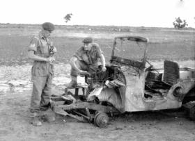 Two soldiers in Suez with a damaged Jeep, 1956.