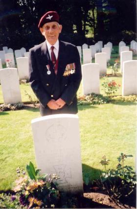 Ralph 'Joe' Sunley in front of Captain Queripel's grave, 2004.