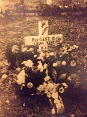 Temporary wooden cross for Harry Cast with floral tributes from his comrades, September 1947.