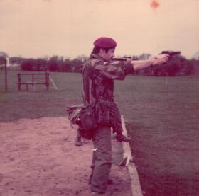 Terry Hughes firing a 9mm Browning, 1970s