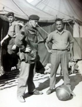 L/Cpl Terry Miller checking a civilian worker entering Whittington camp, Cyprus 1958.