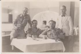 The three must have beers: two members of the 8th Battalion with an RAF NCO, Cairo 1946
