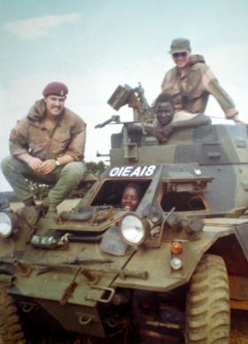 Para Sqn RAC troopers and locals aboard an early Ferret with fixed turret, Kenya, 1972.