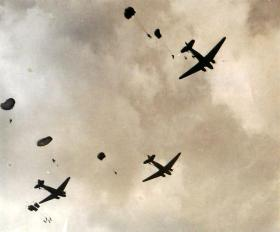 Three aircraft dropping containers for re-supply at Arnhem.
