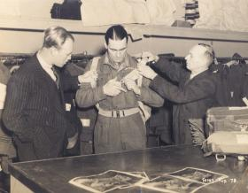 Captain John Timothy at the outfitters, probably early to mid 1944