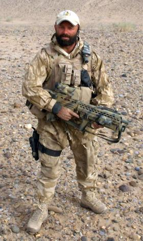 Sgt Tom Blakey with a L85 SA80A2 Underslung Grenade Launcher, Herrick IV, Afghanistan, 2006.