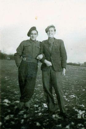 Sgmn Tom Stevens and a local in Belgium, circa January 1945.
