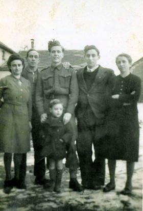 Sgmn Stevens with a Belgian family, circa January 1945.