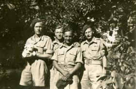 Sgmn Tom Stevens with colleagues and Kim, 1946.
