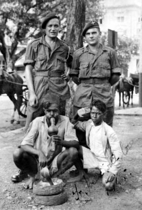 Pte Gordon Townshend and 'Tiffy' with locals in Bombay, 1945.
