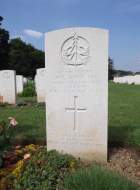 Headstone of Trooper WG Hunt MM, Ranville War Cemetery, 2013.