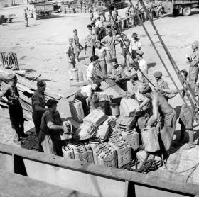 Soldiers and civilians unload supplies during Operation Slapstick, Taranto, September 1943.