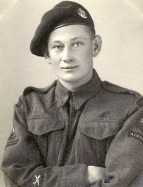 Driver John T V Belfield, date unknown.