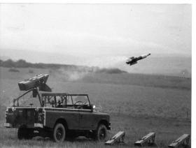 Live firing of a Vigilant mounted on the rear of a Land Rover, Salisbury Plain c1975