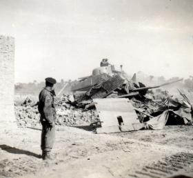 Brig K T 'Katie' Darling watches the demolition of Gaynaeim, Canal Zone, c1952.
