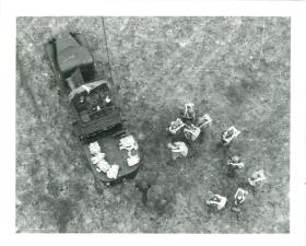 Shot from a raised balloon cage for training jumps. A parachute stick wait on the ground.