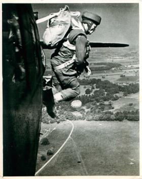 Early paratrooper adopts correct jumping position on exiting the aircraft over Tatton Park.
