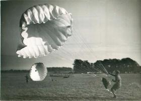 Recruit collapses his parachute after landing at Tatton Park.