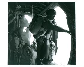 Number 1 of the stick stands in the door of a Dakota ready to jump.